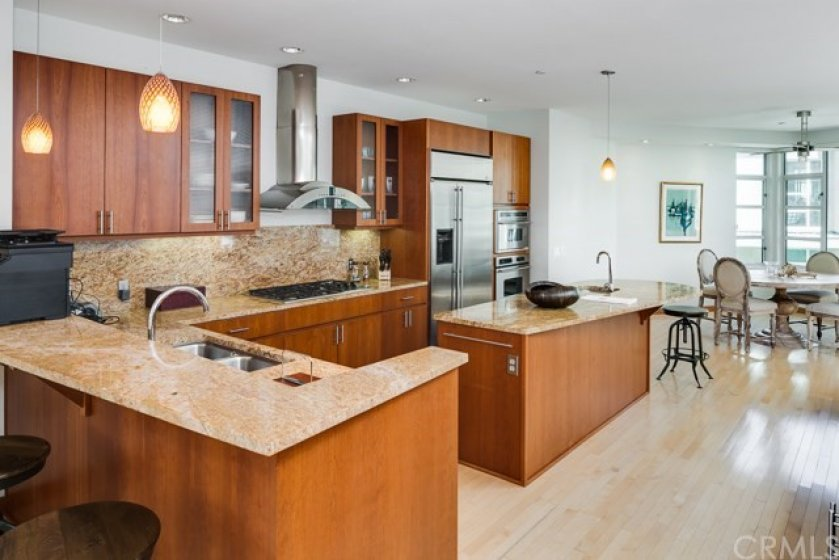 . . .  Wide open kitchen with premium appliances, an abundance of counter space & cabinetry . . .
