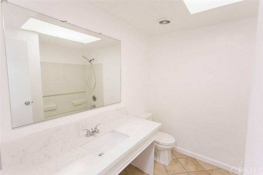 Upper level bathroom with new quartz counters.