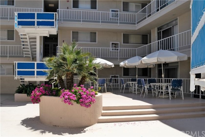 Inside Sea Isle Landing is a wonderful second floor patio for residents to enjoy the beautiful Southern California weather.