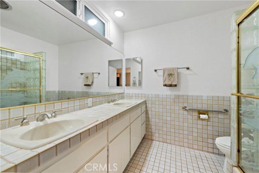spacious master bathroom boasts double sinks