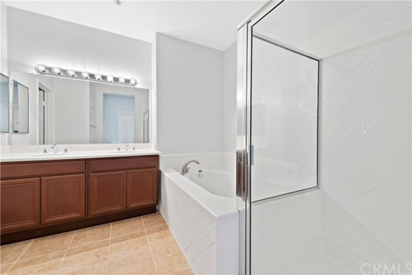 Dual sink master bath, private water closet, large soaking tub and walk in shower.