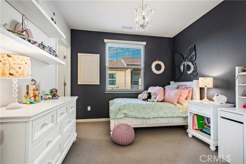 Custom paint and light fixture in bedroom 3.