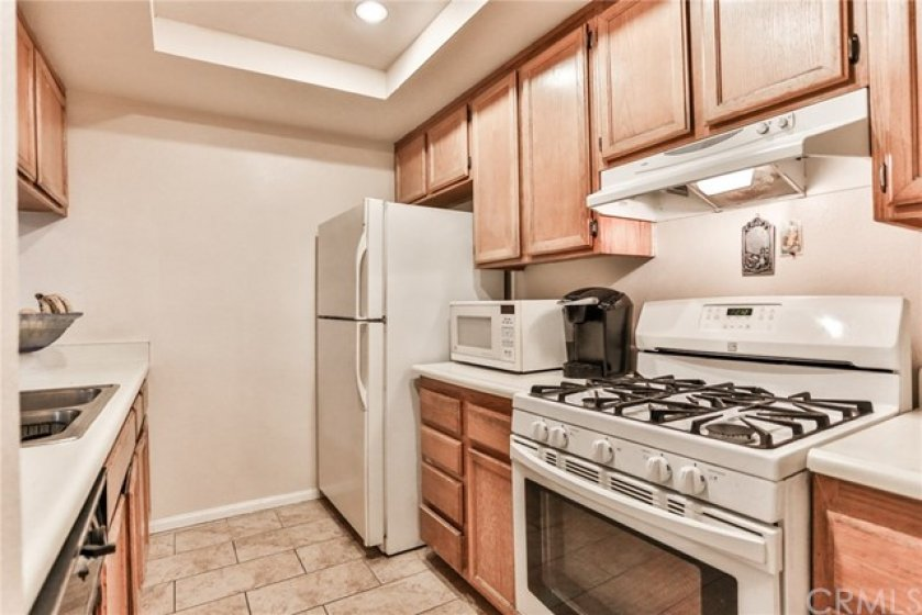 Kitchen with recessed lighting gas stove/oven, stainless steel sink & dishwasher
