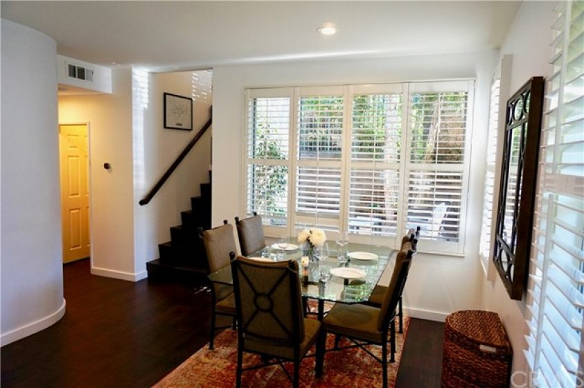 Nice dining room with shutters and view to your peaceful yard.