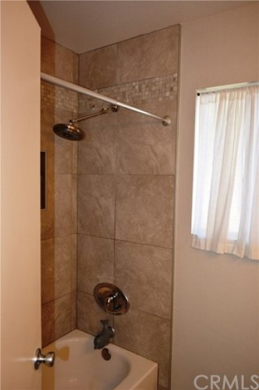 The Shower over Tub area have been tiled with beautiful accents.