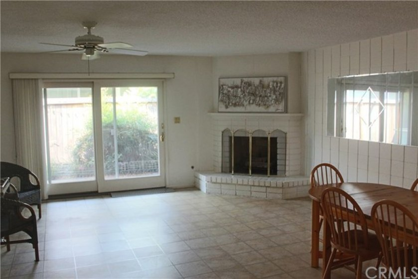 Spacious Family Room, with upgraded sliding door.  Fireplace with a mantle and large hearth.