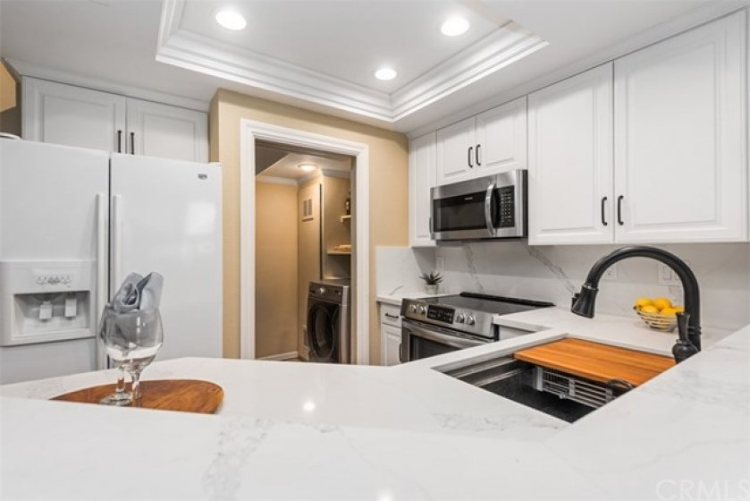 Separate Laundry Room, with extra storage, is close at hand and neatly tucked away.