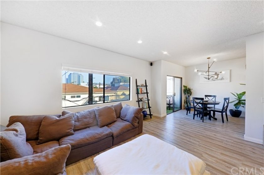 Open view of living, dining and balcony area.  Plenty of natural light.