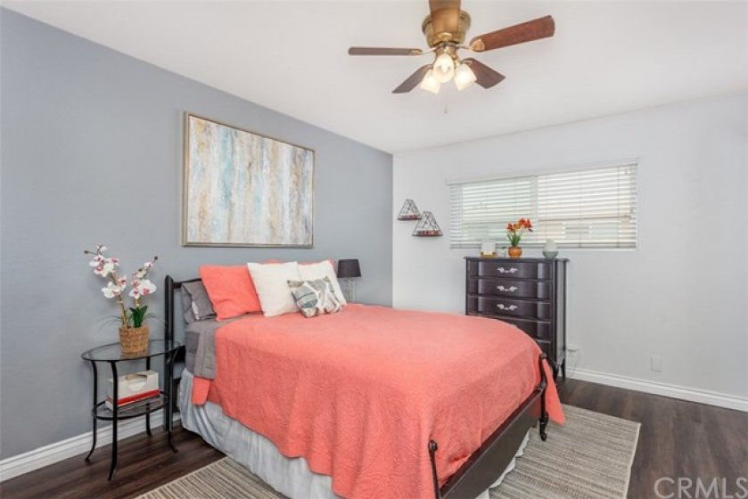 Large bedroom with newer laminate floors.