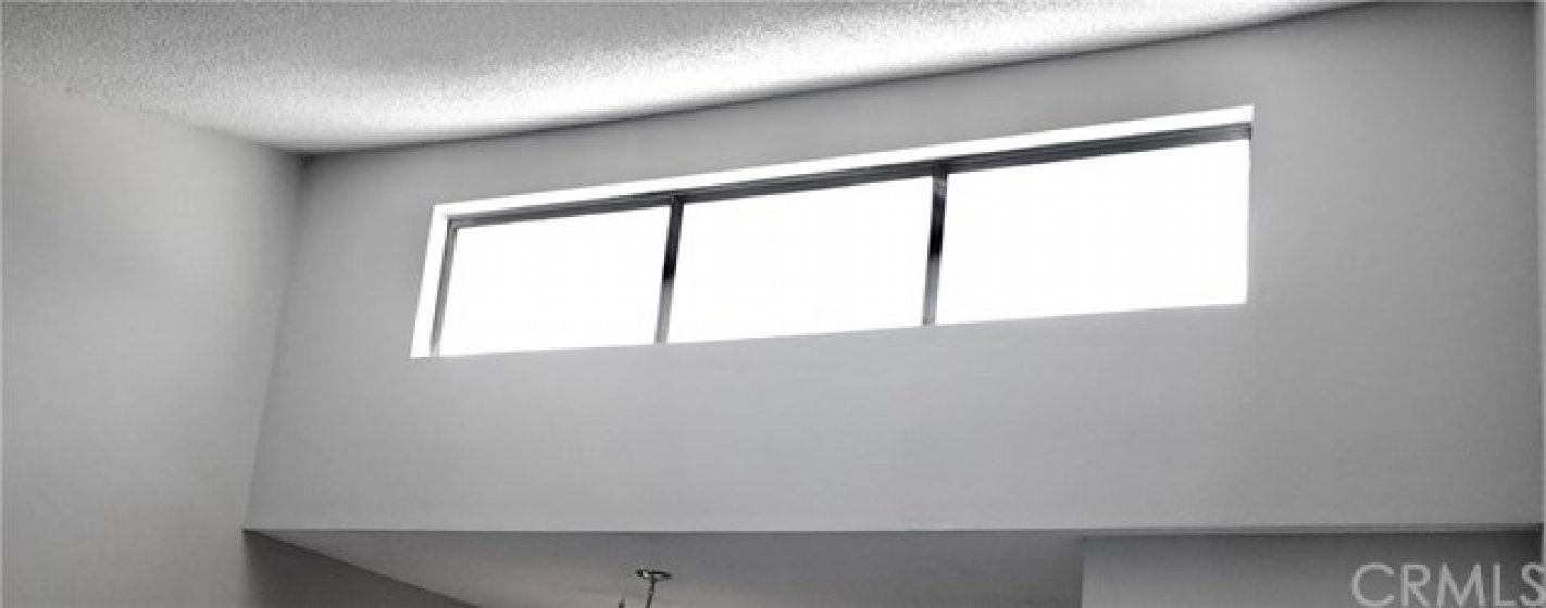 Sky light located in living room upper ceiling, adding extra light. Newly painted.