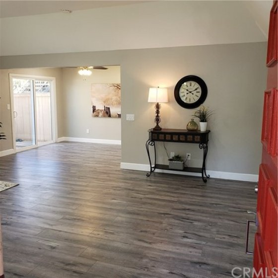 Large, open living room leads to dining area