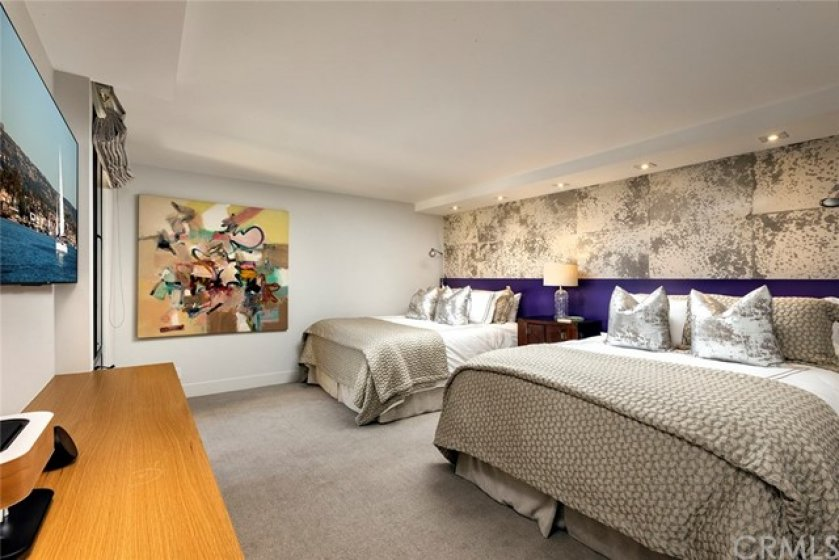 Spacious master suite with bay view will accommodate two queen size beds as shown.
