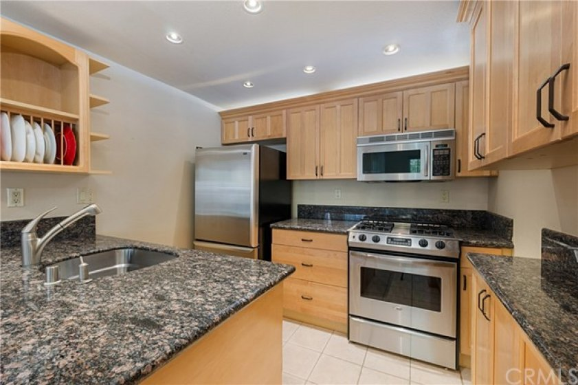 Stainless steel appliances, deep sink, and plenty of lights