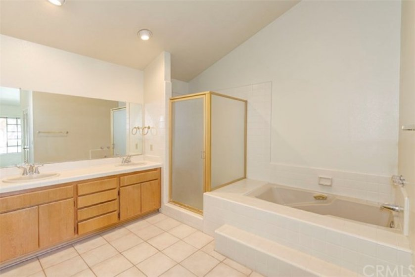 Master bathroom with soaking tub, shower, double vanity, and water closet!