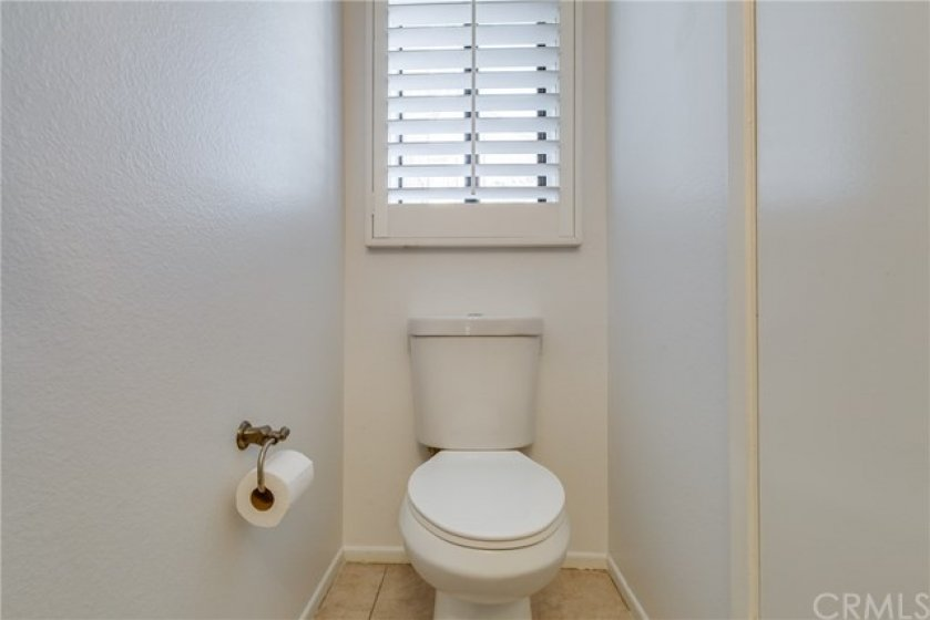 Downstairs powder room with window