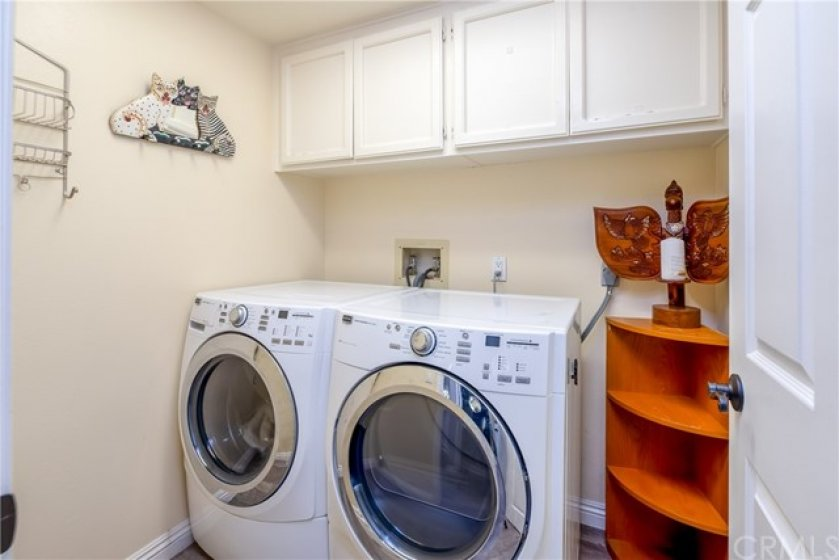 LAUNDRY ROOM inside with storage cabinets above.