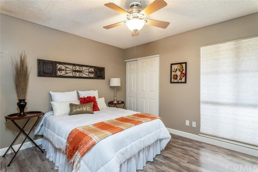 First Floor bedroom includes: a window to the deck, two wardrobe closets with raised panel doors and ceiling fan with light.