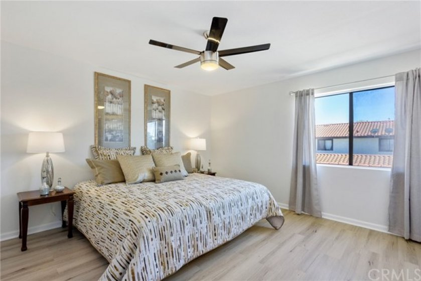 Large master bedroom fully updated with a walk-in closet.