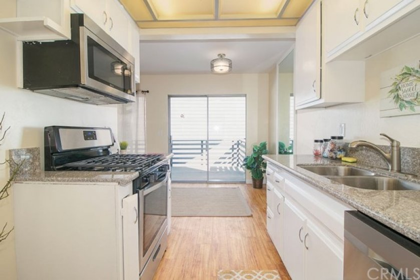 Plenty of cabinets and counter space in this kitchen along with matching stainless steel appliances.