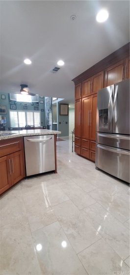 Porcelain flooring and custom built Cherry Wood Cabinetry.