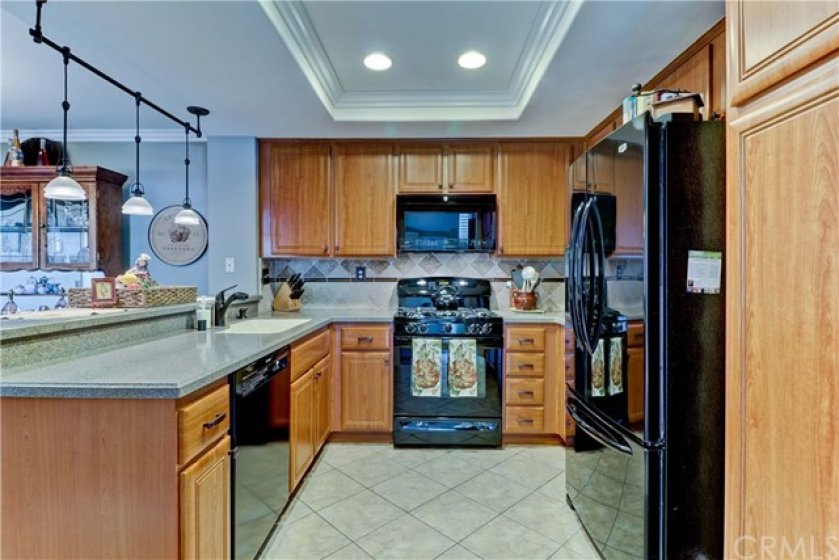 Updated kitchen with gas stove and newer appliances.