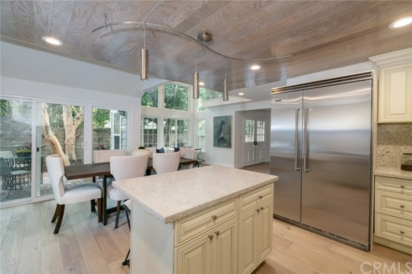 Kitchen's Island w Wood Ceiling looking to the sitting area and patio
