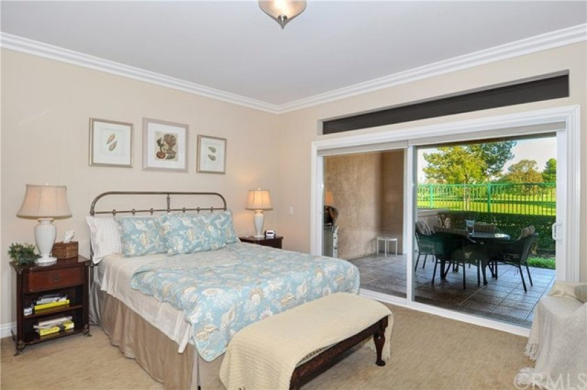 Wake up to your golf course view through extra wide glass sliders.