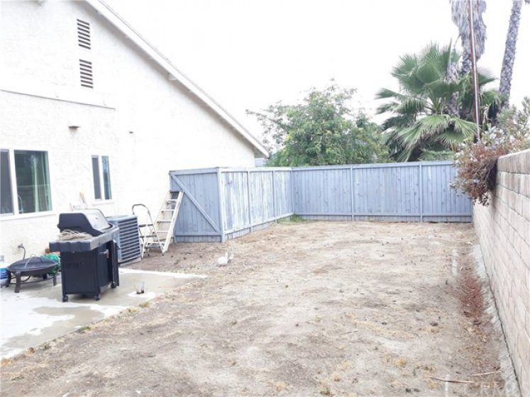 Nice sized yard with patio slab and a gate to the common area.
