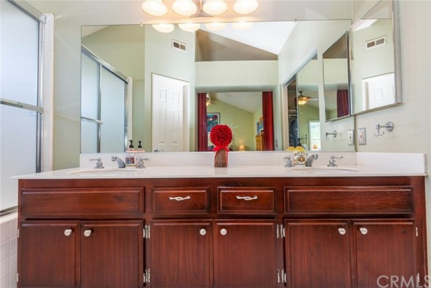 Master bath has plenty of cabinets for extra storage space.