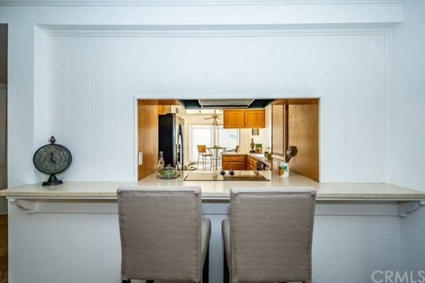 Fitting bar top in the family room from the kitchen counter which is perfect for entertaining.