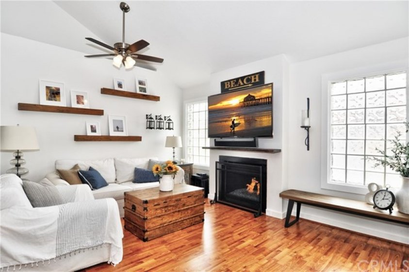 Cozy family room with remodeled gas fireplace and glass block, bringing in the natural light