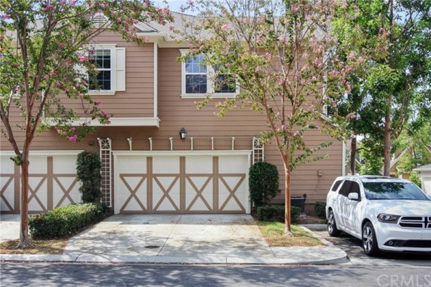 End unit with two-car attached garage and a full driveway for additional parking!