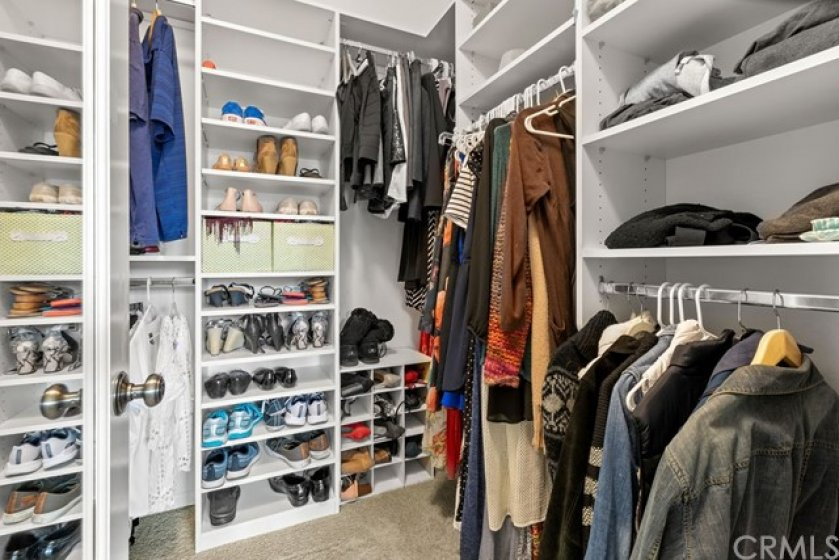 Large Master Suite walk-in-closet with built-ins for extra storage!