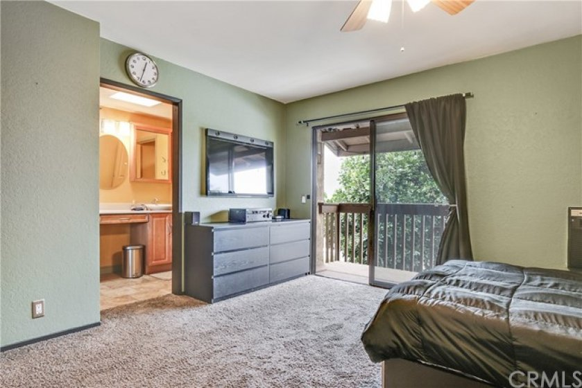 The master bedroom is large an has a balcony.