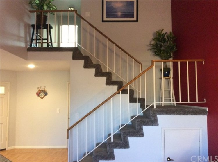 STORAGE UNDER STAIR LANDING LEADS TO BEDROOMS