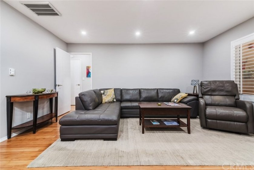 Living room is large enough for a sectional and a recliner.