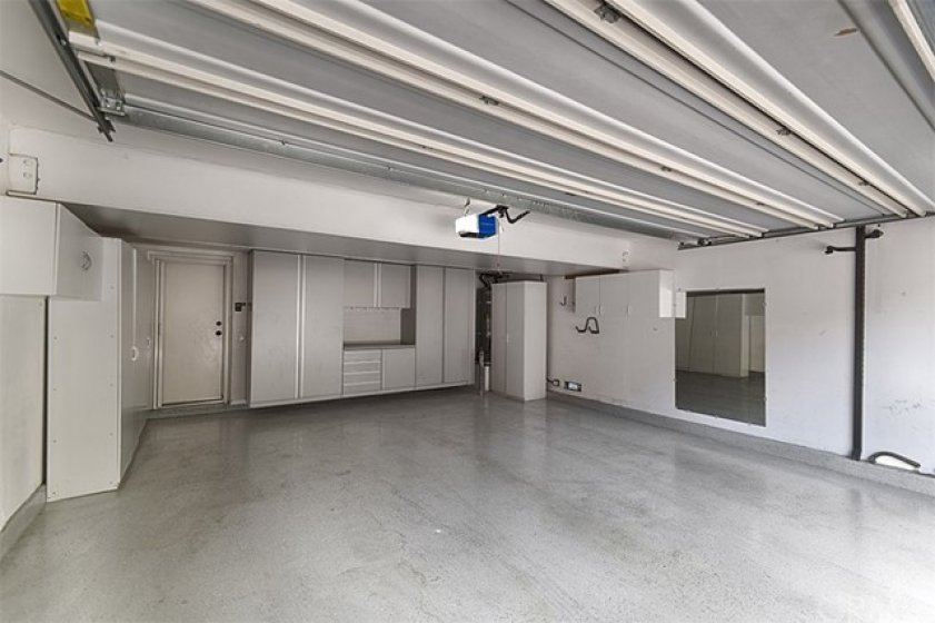 Loads of storage above and on 3 sides of the of this garage with epoxy floor and direct access.