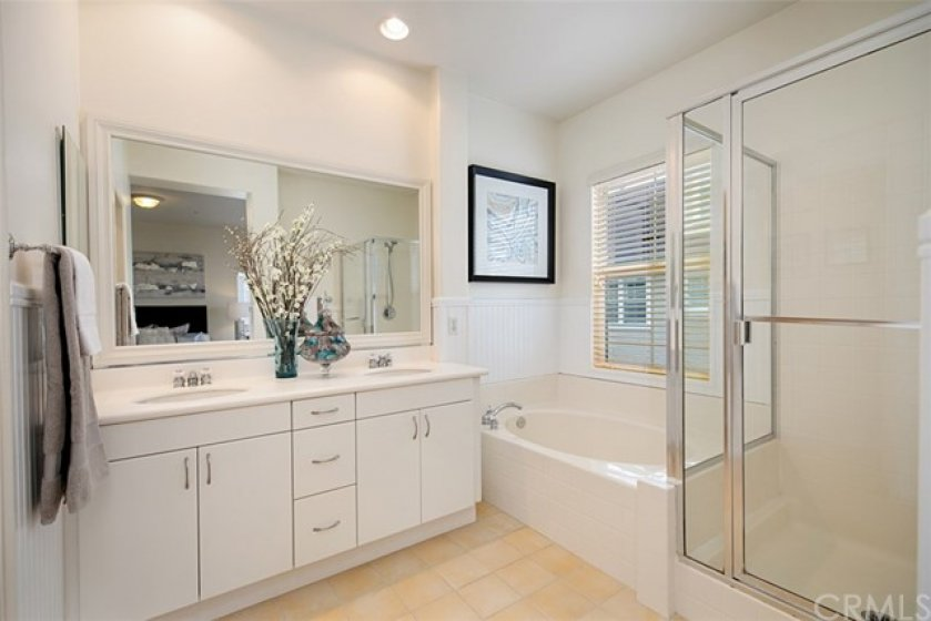 Master bath offers two vanities, Roman soaking tub and walk-in shower.
