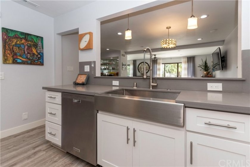 Open wall to the dining room makes the kitchen feel even larger!