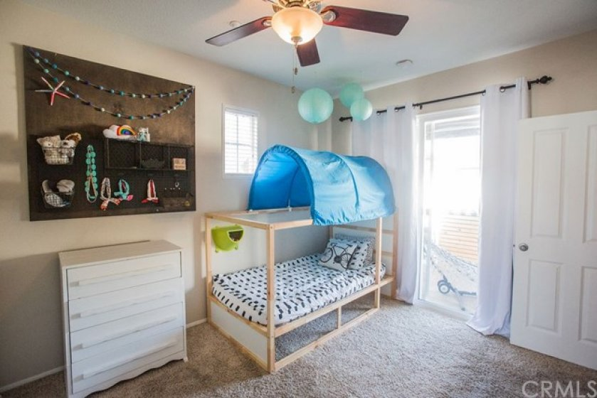 The secondary bedroom also features a slider to the private covered deck.