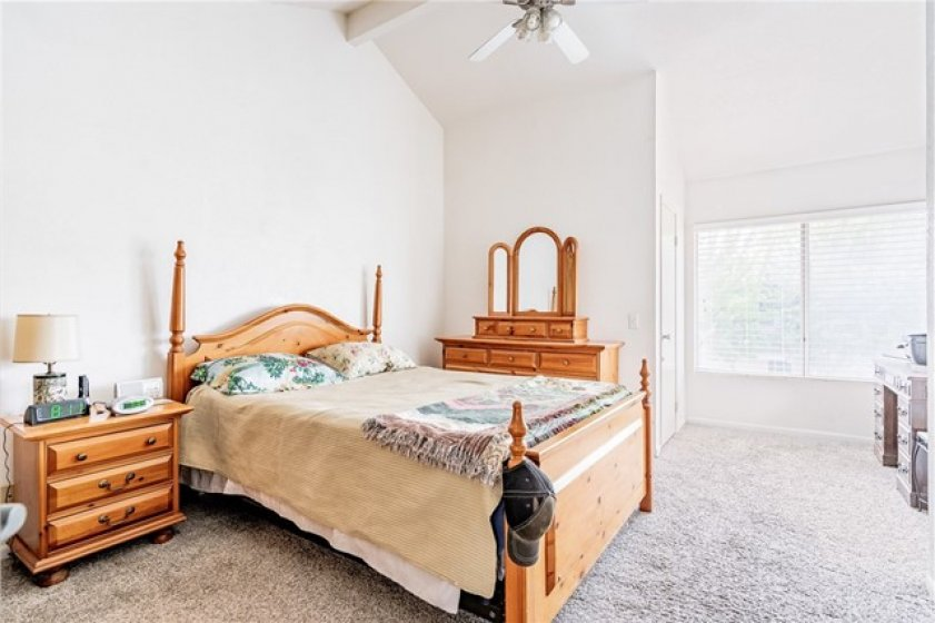 Main Bedroom has vaulted ceilings, a walk in closet and a fan too! Wonderful southern exposure!