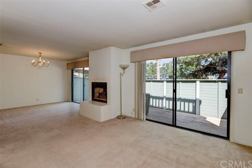 Dining room adjacent to living room, with patio access