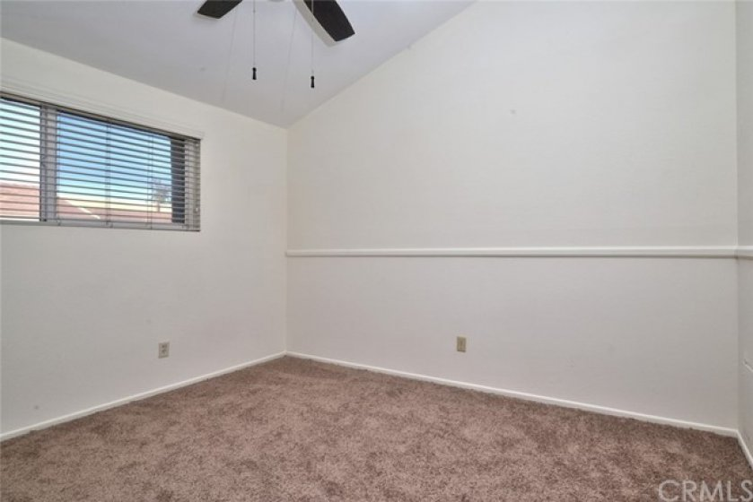 Bedroom #4 is also spacious, has chair rail molding and also has cathedral ceilings and a cooling ceiling fan.