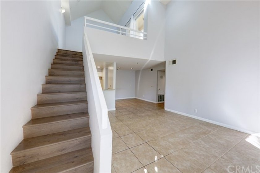 Stairs leading to loft (3rd room, office, den)
