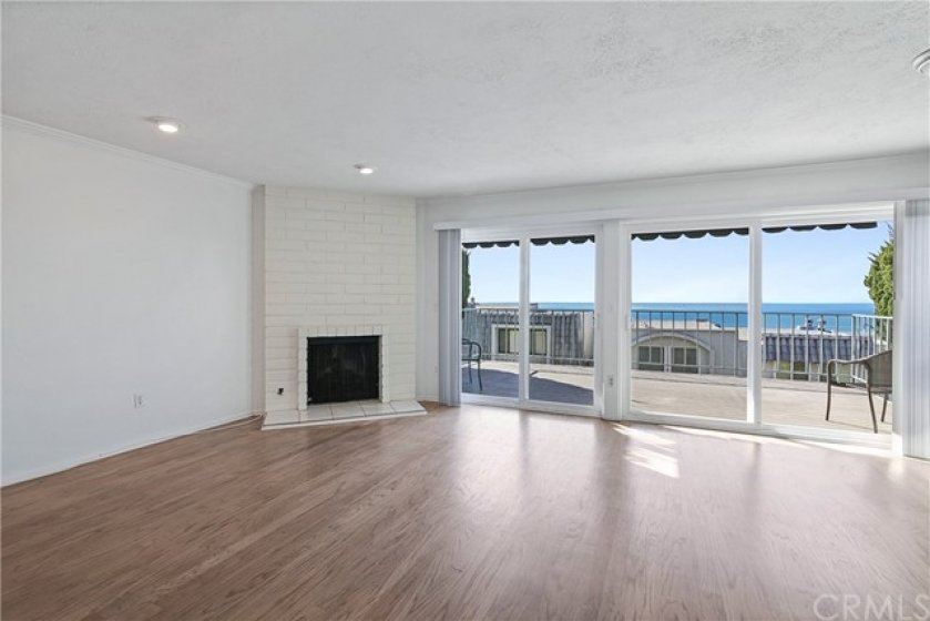 The living room opens onto an expansive deck