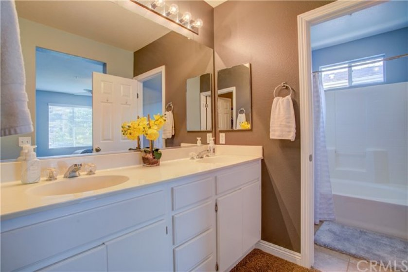 Master bathroom vanity is center to walk in closet and privacy door to toilet and bathtub.