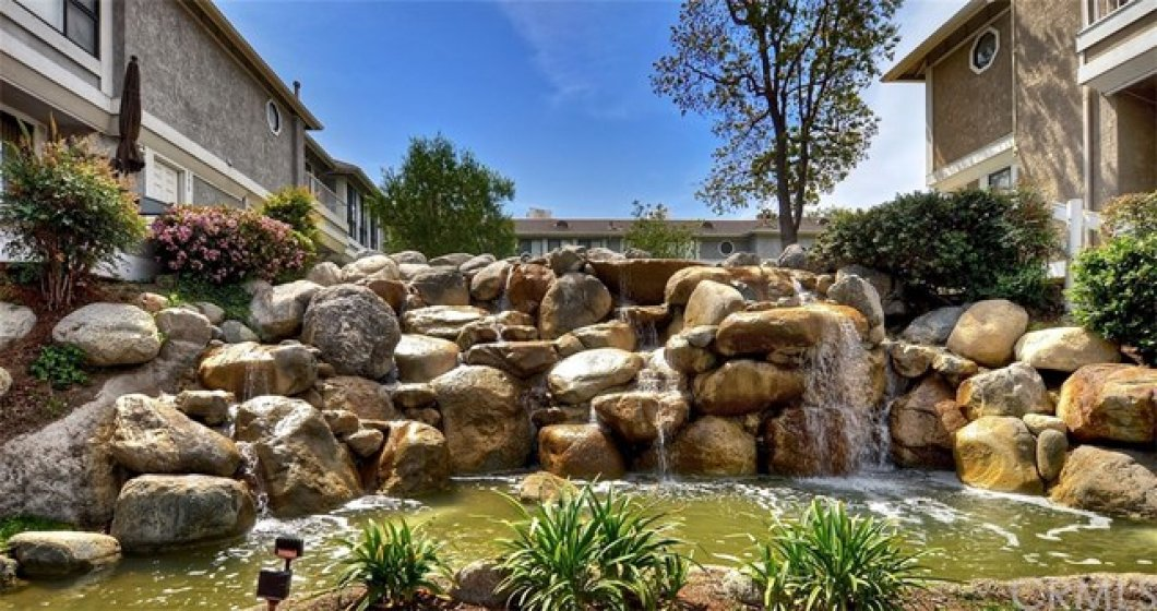 Rock waterfall at entrance of the Waterscape community, adjacent to guest parking area