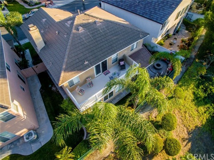 AERIAL VIEW OF HOME FROM BEHIND