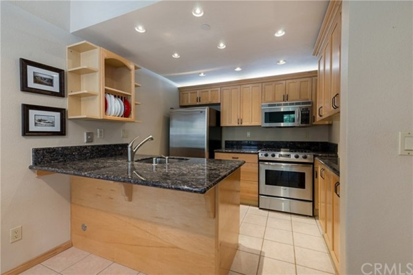 Beautifully upgraded Kitchen with Granite counters and breakfast bar.