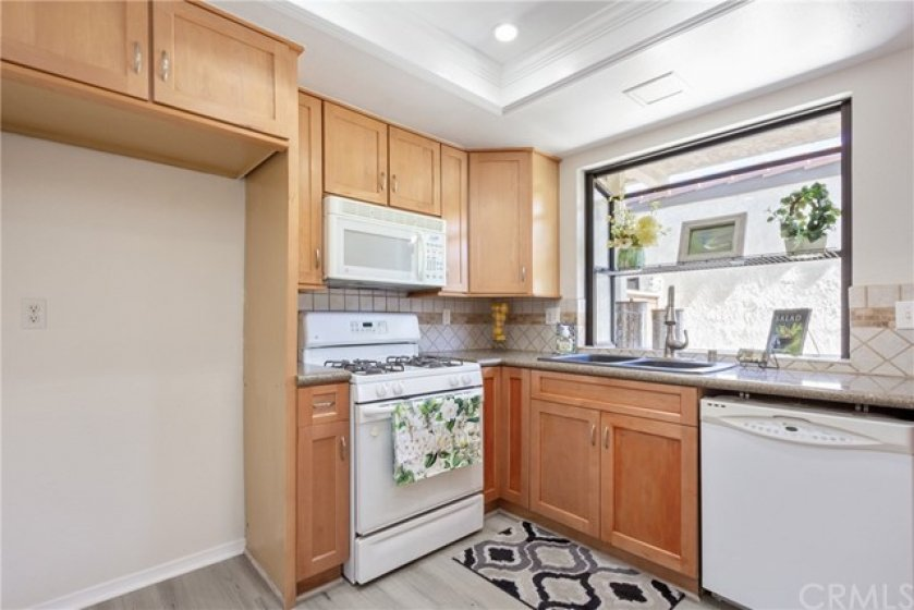 Nice sized kitchen with granite counter tops.